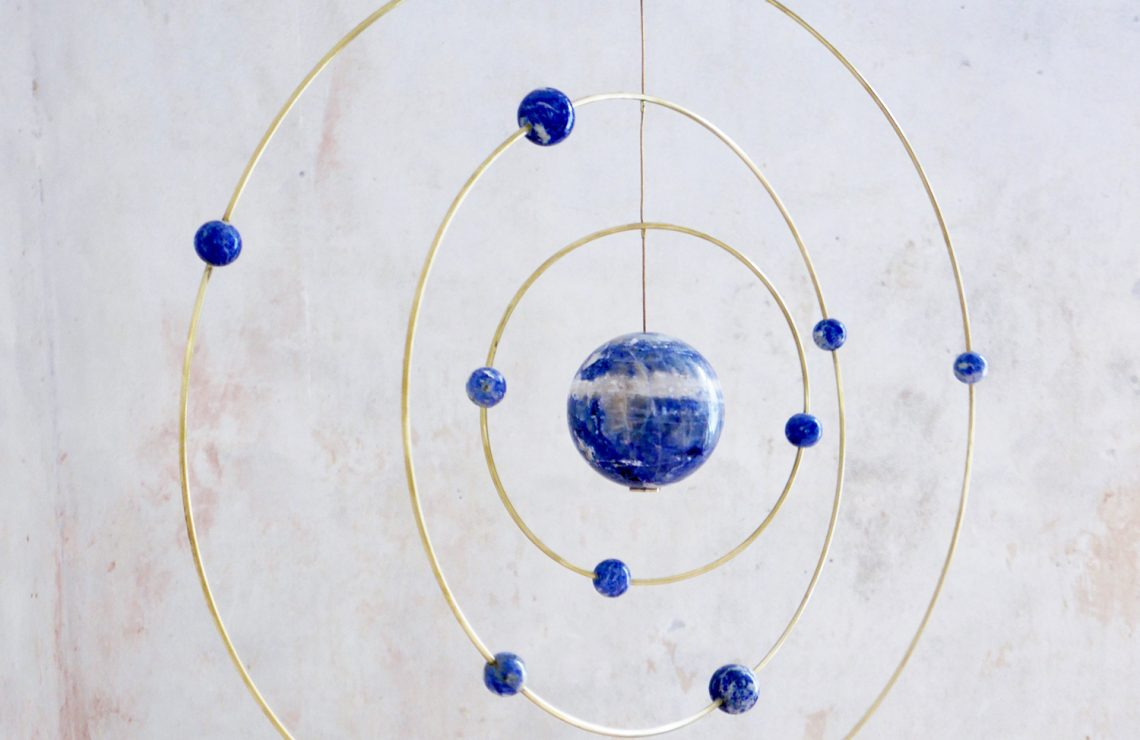 hanging GalaxyGlobe interior in messing and marble